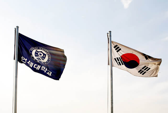 Yonsei and Korean Flags in the wind